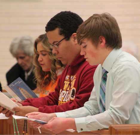Holy Cross High School students lead the rosary for life in our chapel.